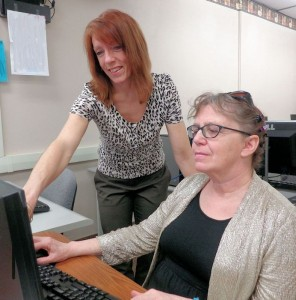 Joyce Golden, instructor from Erie 2-Chautauqua-Cattaraugus BOCES, assists Cathy Hamlet during a computer class at Prendergast Library, where the schedule of April classes is available.