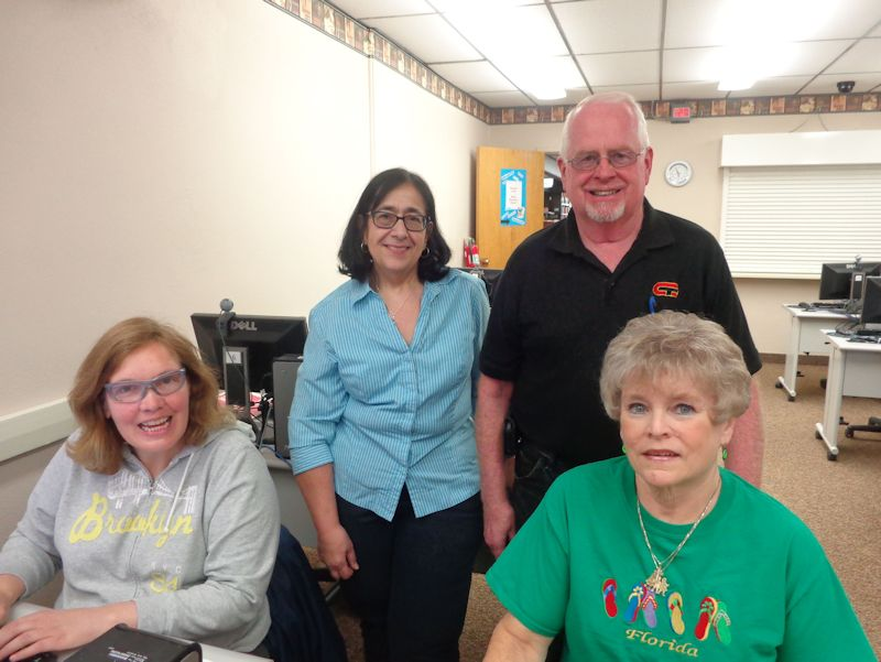 Karen Bowen, instructor Rose Lancione, and Craig and Cindy McNallie, left to right, participate in a computer class at Prendergast Library, where the schedule of June classes is now available.